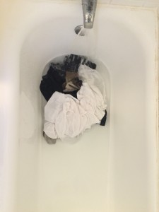 Clothes tossed into the tub